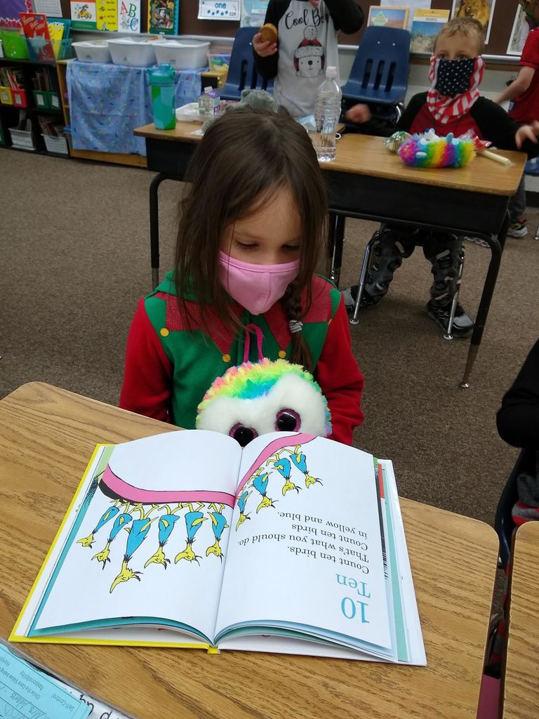 "First Graders ""cuddle up with a good book"" in PJs!"