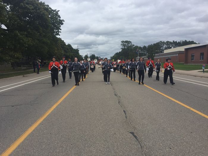 The band marching down 115
