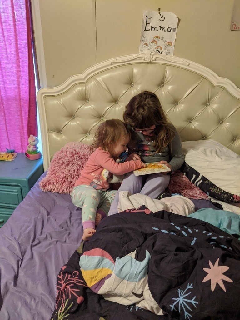Reading stories to siblings!